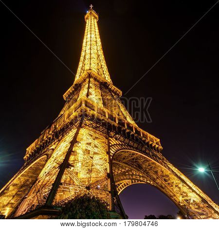 PARIS - SEPTEMBER 24: Lighting of the Eiffel tower at night on september 24, 2013 in Paris. The Eiffel tower is one of the major tourist attractions of France.