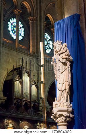 PARIS - SEPTEMBER 25, 2013:The Statue of Virgin and Child inside Notre-Dame de Paris, France.