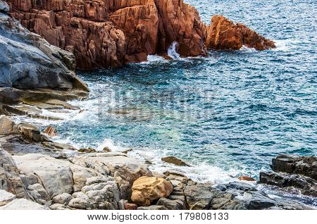 Arbatax the red porphyry rocks nearby port Capo Bellavista sardegna Sardinia Italy Europe