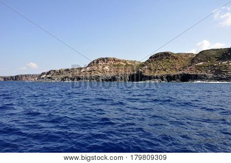 Blue sea and characteristic caves of Cala Luna Golfo di Orosei Sardegna or in Sardinia Italy