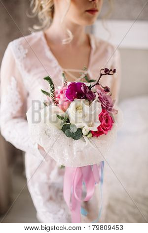 Beautiful Girl In Tender Lacy Dress With Bouquet Flowers Peonies In Hands Standing Against Floral Ba