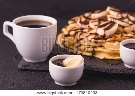 Cup Of Coffee And Waffles With Banana And Chocolate