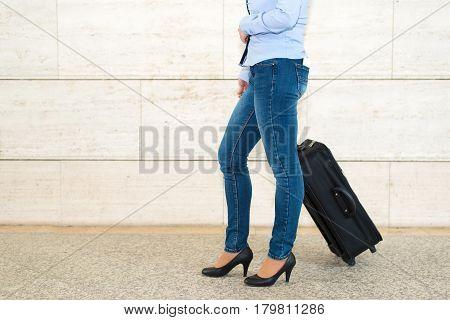 Traveler Woman Walking Her Suitcase