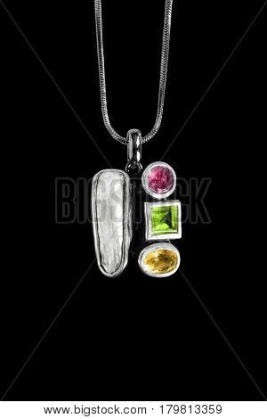 Vintage pendant with crystals and nacre isolated over black