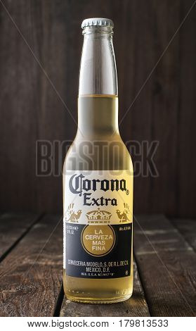 Editorial Photo Of Bottle Of Corona Extra Beer On Dark Wooden Background