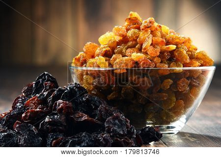 Composition With Bowl Of Raisins On Wooden Table