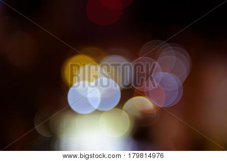 Abstract bokeh background. Multicolored lights on a black background