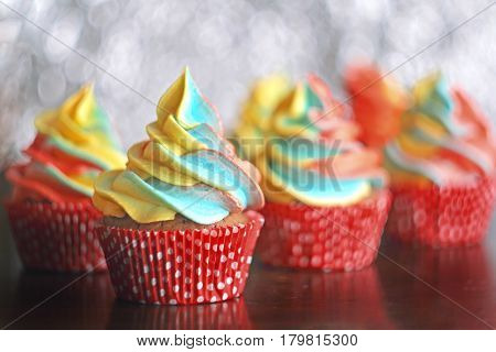 Rainbow cupcakes. Chocolate cupcakes with multicolored frosting. Selective focus.