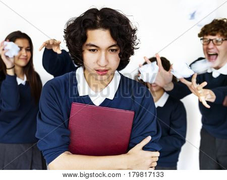 Group of students bullying friend pressure