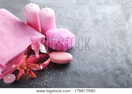 Towels With Soap, Wisp And Bottle On A Grey Wooden Table