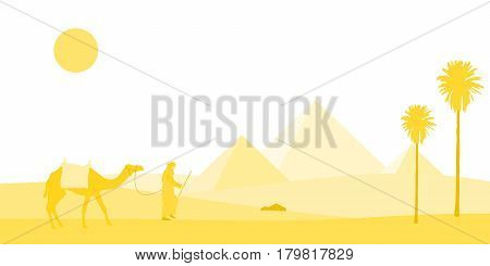 Egypt. A bedouin and his camel in a yellow desert landscape with pyramids in the background