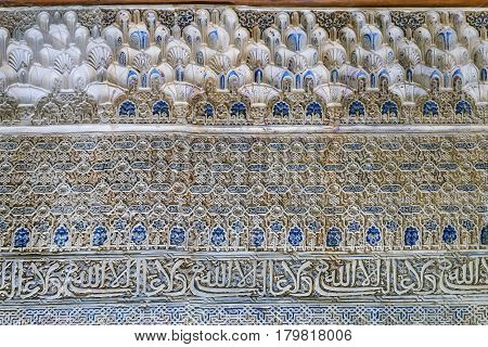 Stone relief with arabesques in Alhambra palace Spain