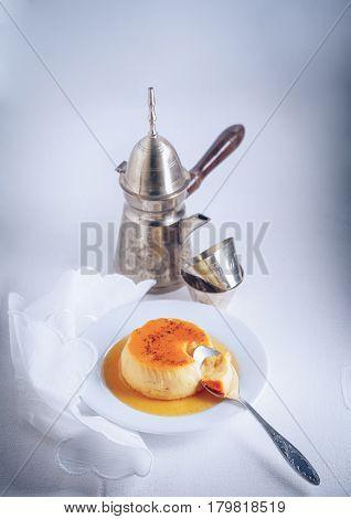 Homemade Creme Caramel with a spoon. Flan.