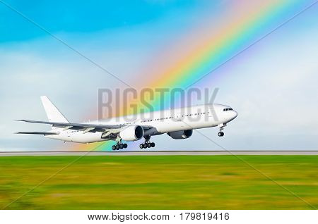 The airplane on the background of the rainbow landed at the airport.