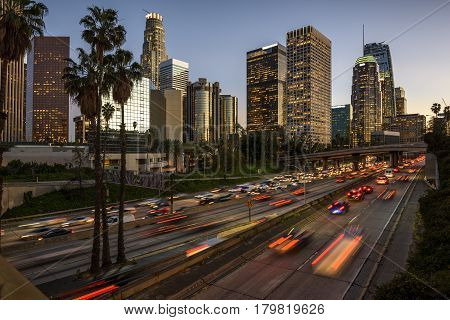 Traffic in downtown Los Angeles California at sunset