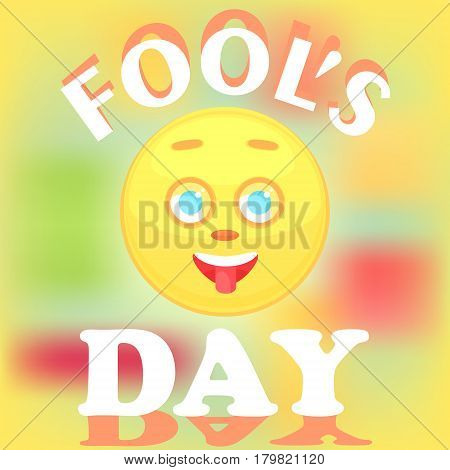 Festive card for the day of the fool. The face of the smiley icon shows the tongue the cheerful is isolated on a blurry background the text with a shadow.