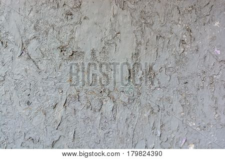 Close up texture of cracked dye on obsolete weathered cement wall surface