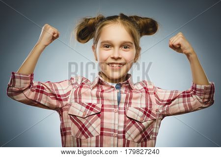 Funny Strong serious girl showing his hand biceps muscles.