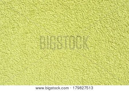 Closeup uneven rough light green plaster texture background
