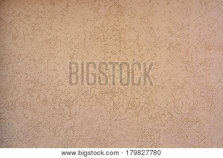 Closeup uneven rough beige plaster texture background