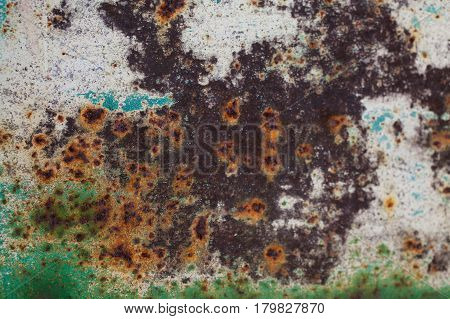 Rusted door texture. Closeup of old green metal. Rusty metal background & texture. Metal corroded. Abstract texture & background for designers. Grunge old rusty scratched surface texture.