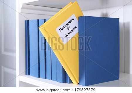 Book of MANAGEMENT BY OBJECTIVES on shelf