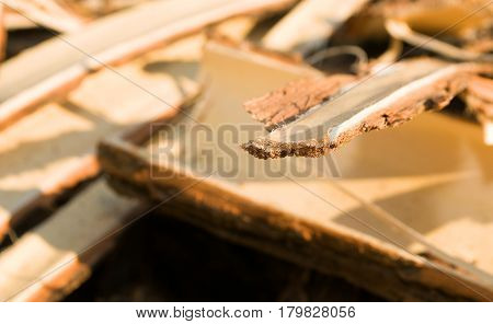Brown scrap of wood scraping during sunny day