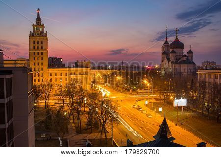 Evening Voronezh. Tower of management of south-east railway in the style of Stalin's empire and Annunciation Cathedral at sunset background