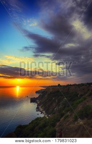 Dramatic clouds at sunset. Coastal view at sunset