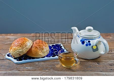 Studio shot of pastries and tea on a table