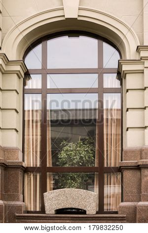 Arched window with redeveloped wall background