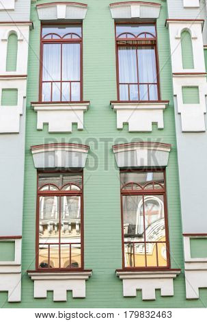 Vintage building and windows with brick wall background