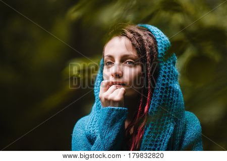 Young Charming Girl With Dreads In A City Park On A Bright Day.