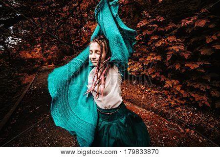 Teenage Girl Walking In Park In Sunny Day