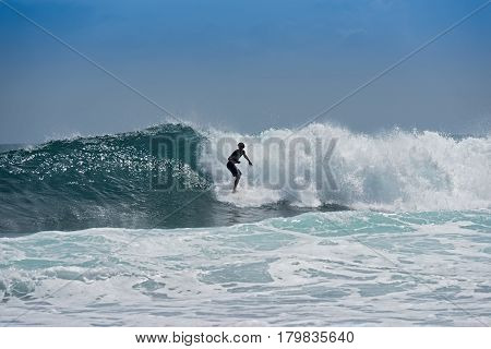 PUERT VIEJO, COSTA RICA-MARCH 19, 2017: Surfer on the beach near Puerto Viejo, Costa Rica