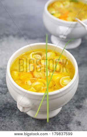 Vegetable crab sticks soup in two tureen. Focus selective