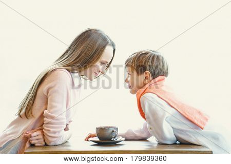Mother and child in cafe