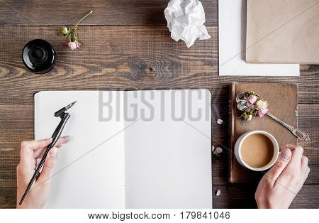 author office in professional writer concept with hands on wooden work desk background top view