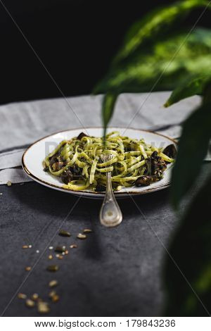 Vertical View of Mushroom Linguine on Plate with Fork