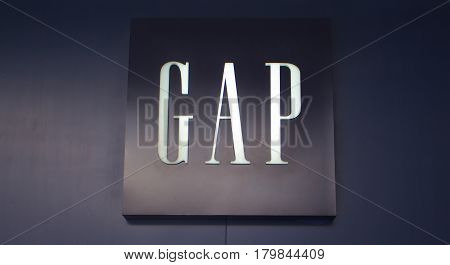 Manila Philippines - 26 June 2016: Logo of famous fashion brand Gap in Mall of Asia Philippines. Casual clothes and denim shop. Mass-market unisex wear. Fashion store entrance. Retail industry