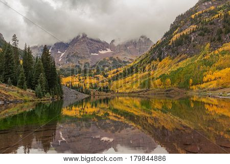 a scenic autumn reflection at Maroon Bells Aspen Colorado