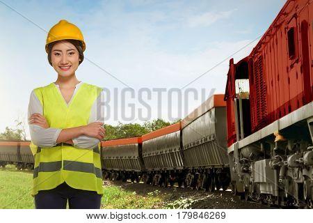 Beautiful Asian Railway Employee Woman Standing Beside Freight Train