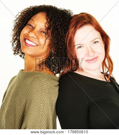 Two Attractive Women Over White Background