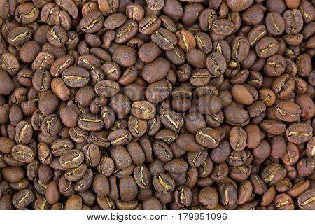 Closeup texture of very dark brown roasted coffee beans. Costa Rica La Rosalia mixed with Kenya Kiawamururu AB coffeebeans