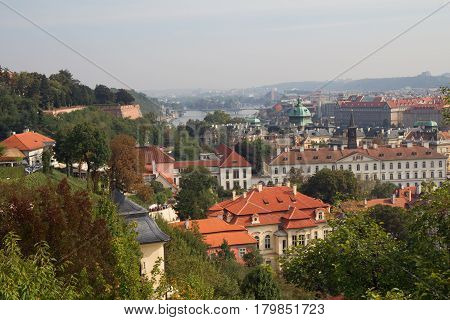 Prague view from above with Vltava river in far background