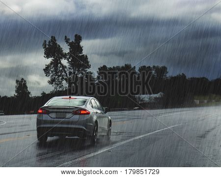 Driving in rain. Wet road with car.