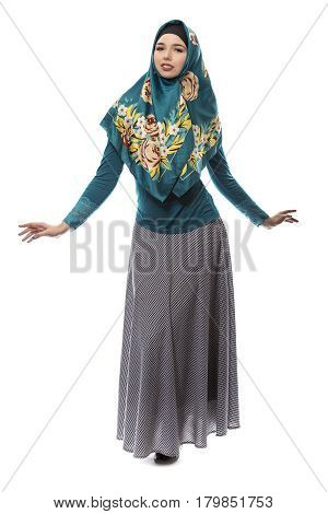 Multiracial female wearing a stylish green hijab mostly associated with middle east islamic and eastern european cultures. The image depicts conservative modern fashion.
