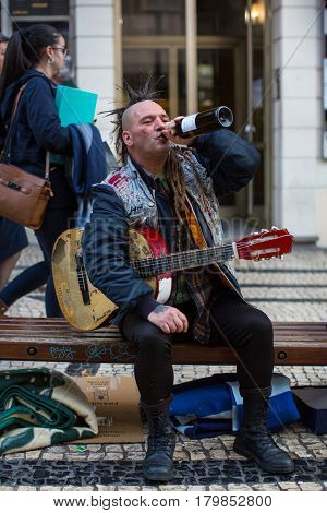 PORTO, PORTUGAL - DEC 9, 2016: Unknown street musician on the one of the streets in the historical centre of Porto old town. City of Porto won the European Best Destination 2012 and 2014 awards.