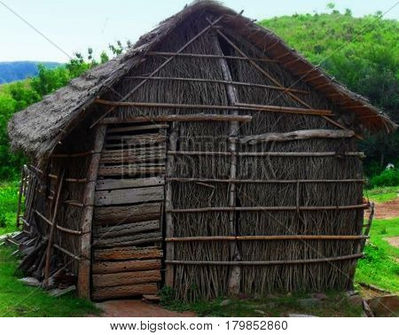 Stick hut. Simple house made with sticks. Sticks shack. Wood hovel
