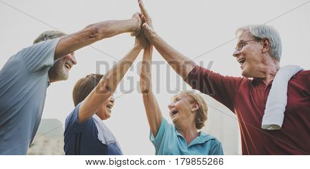 Senior Adult Teamwork Hands Together